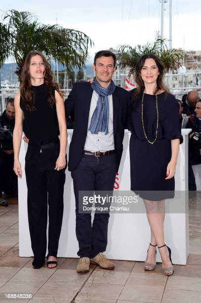 Actress Marine Vacth, director Francois Ozon and actress Geraldine Pailhas attend the photocall for 'Jeune & Jolie' during the 66th Annual Cannes...