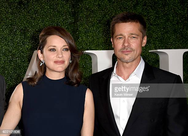 Actress Marion Cotillard and actor Brad Pitt attend the fan event for Paramount Pictures' Allied at Regency Village Theatre on November 9 2016 in...