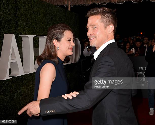 Actress Marion Cotillard and actor Brad Pitt attend the fan event for Paramount Pictures' 'Allied' at Regency Village Theatre on November 9 2016 in...