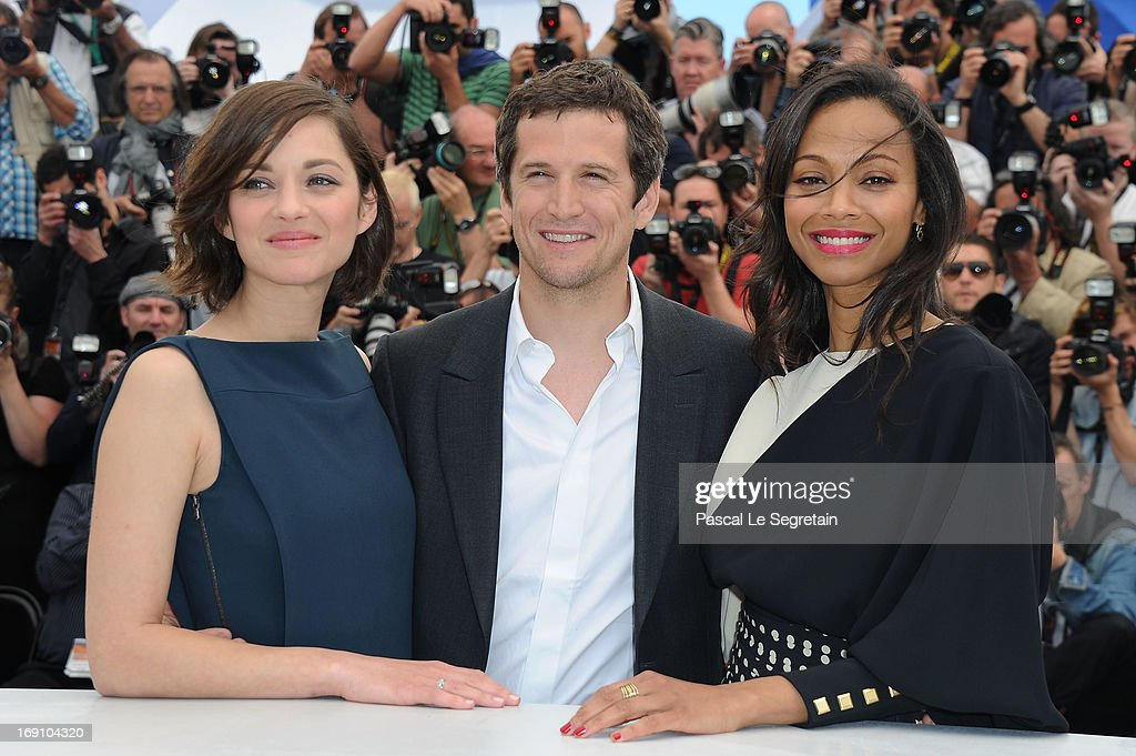 Actress Marion Cotillard and director and actor Guillaume Canet and actress Zoe Saldana attend the photocall for 'Blood Ties' at The 66th Annual Cannes Film Festival on May 20, 2013 in Cannes, France.
