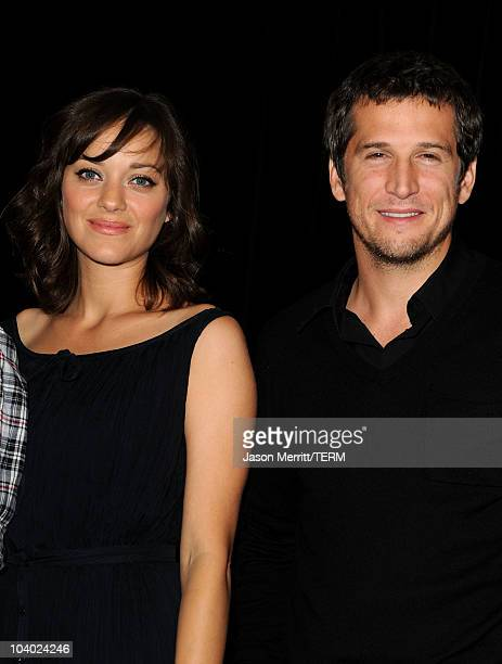Actress Marion Cotillard and director Guillaume Canet pose at 'Little White Lies' press conference during the 2010 Toronto International Film...