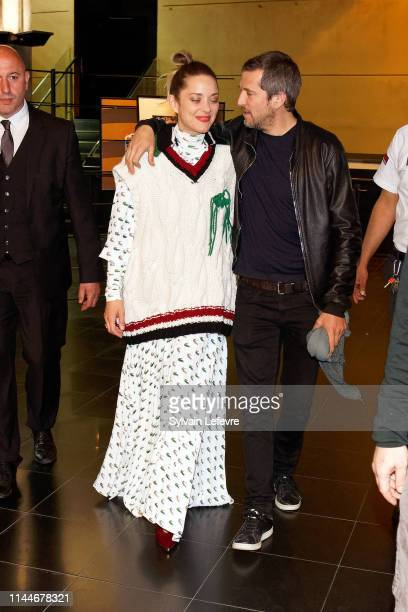 """Actress Marion Cotillard and her husband and film director Guillaume Canet attend the """"Nous finirons Ensemble"""" premiere at UGC De Brouckere on April..."""