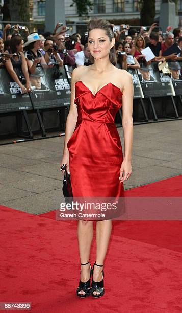 Actress Marion Cotillard arrives at the European Film Premiere of 'Public Enemies' at The Empire Leicester Square on June 29 2009 in London England