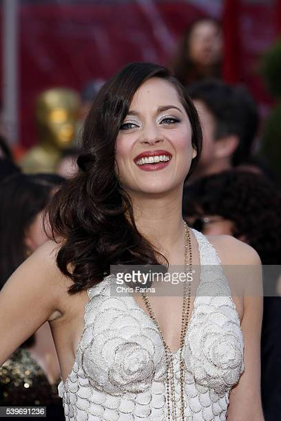 Actress Marion Cotillard arrives in a JeanPaul Gaultier gown jewelry by Chopard and shoes by Sergio Rossi at the 80th Academy Awards® held at the...