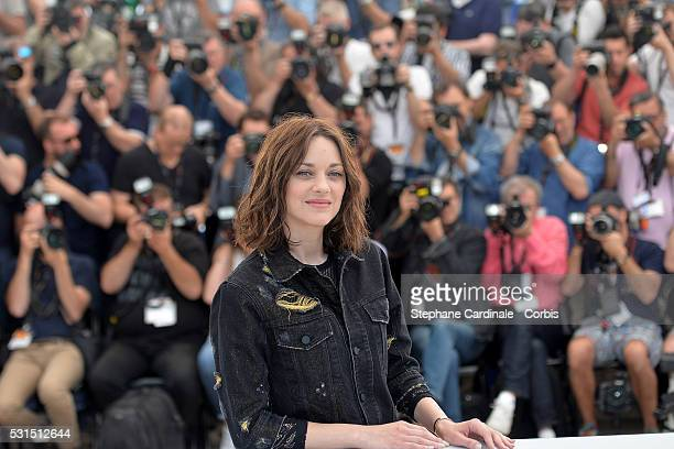 """Actress Marion Cotillard attends the """"From The Land Of The Moon """" photocall during the 69th annual Cannes Film Festival at the Palais des Festivals..."""