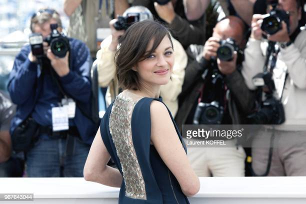 Actress Marion Cotillard attends the photocall for 'Blood Ties' during the 66th Annual Cannes Film Festival at the Palais des Festivals on May 20...
