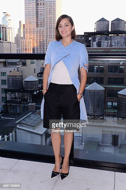 Actress Marion Cotillard attends the Two Days One Night premiere hosted by Sundance Selects with Dior Beauty and The Cinema Society at Spyglass...