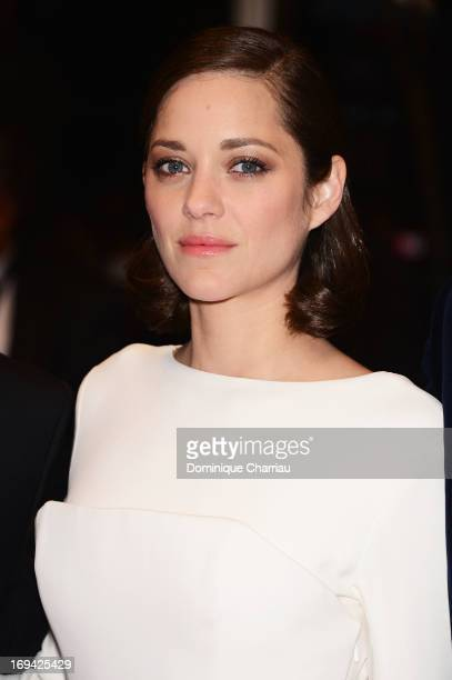 Actress Marion Cotillard departs the Premiere of 'The Immigrant' at The 66th Annual Cannes Film Festival at Palais des Festivals on May 24 2013 in...