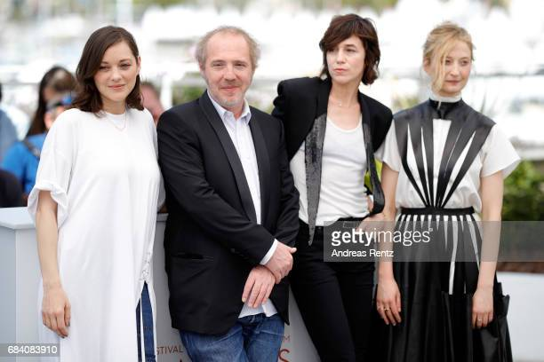 Actress Marion Cotillard director Arnaud Desplechin actresses Charlotte Gainsbourg and Alba Rohrwacher attend the 'Ismael's Ghosts ' photocall during...