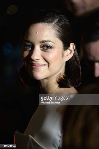 Actress Marion Cotillard leaves the 'The Immigrant' premiere during The 66th Annual Cannes Film Festival at the Palais des Festivals on May 24 2013...