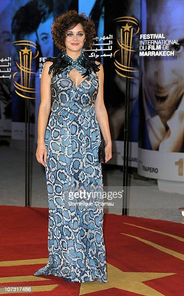 Actress Marion Cotillard Poses as she arrives at the Opening Ceremony of the Marrakech 10th International Film Festival on December 3 2010 in...