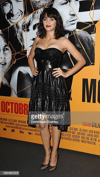 Actress Marion Cotillard poses as she attends the Les Petits Mouchoirs Paris Premiere at Cinema UGC Normandie on October 14 2010 in Paris France