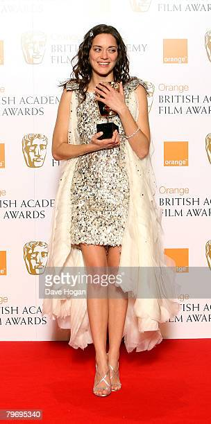 Actress Marion Cotillard poses in the Awards Room with the award for Best Leading Actress at The Orange British Academy Film Awards at the Royal...