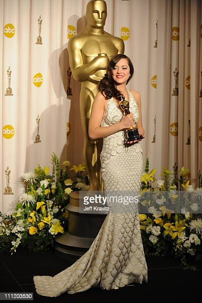 Actress Marion Cotillard poses in the press room during the 80th Annual Academy Awards at the Kodak Theatre on February 24, 2008 in Los Angeles,...