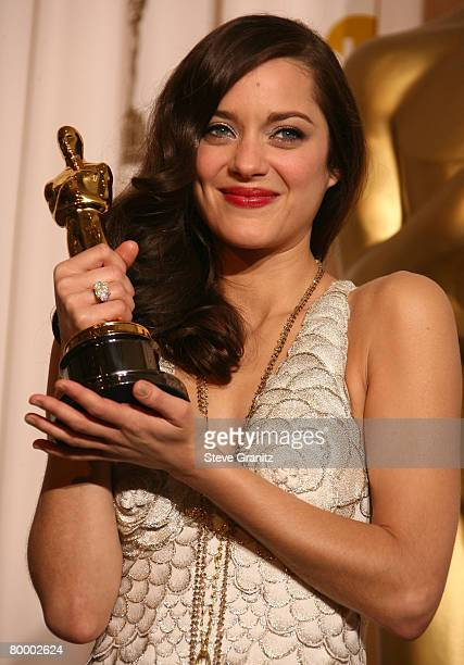 Actress Marion Cotillard poses in the press room during the 80th Annual Academy Awards at the Kodak Theatre on February 24 2008 in Los Angeles...