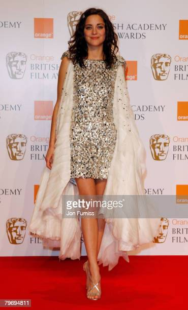 Actress Marion Cotillard poses in the Press Room during The Orange British Academy Film Awards 2008 at The Royal Opera House Covent Garden on...