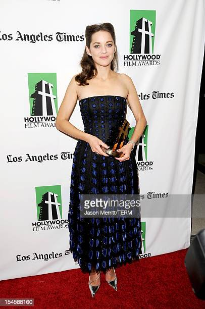 Actress Marion Cotillard poses with the Hollywood Actress Award during the 16th Annual Hollywood Film Awards Gala presented by The Los Angeles Times...