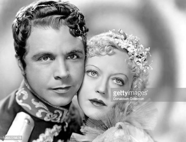 Actress Marion Davies and Dick Powell in a scene from the movie Hearts Divided