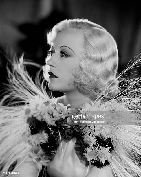 Actress Marion Davies around the time of her appearance in the 1935 movie Page Miss Glory wears a feather decorated dress