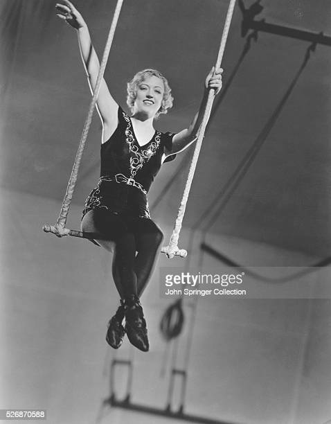 Actress Marion Davies sits on a trapeze on the set of her 1932 film Polly of the Circus starring opposite Clark Gable playing the role of trapeze...