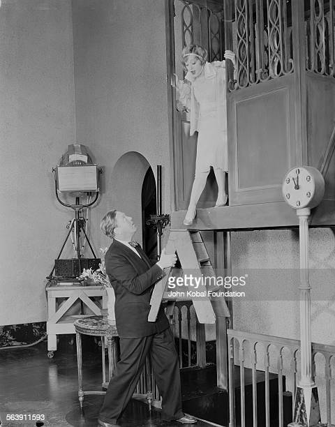 Actress Marion Davies standing on a high platform on the set of the film 'The Cardboard Lover' for MGM Studios May 9th 1928