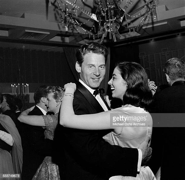 Actress Marisa Pavan with husband actor JeanPierre Aumont dance during the Academy Awards party in Los AngelesCA