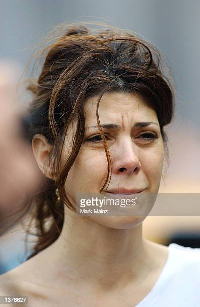 Actress Marisa Tomei attends a mass ceremony at Union Square on the first anniversary of the World Trade Center Attacks September 11 2002 in New York...