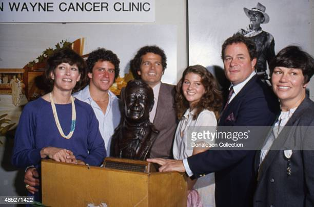 Actress Marisa Wayne Patrick Wayne and the rest of the Wayne family poses for a portrait at the opening of the John Wayne Cancer Institute in 1981 in...