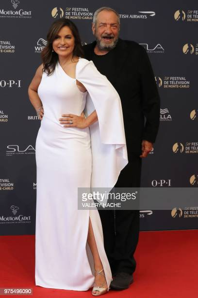 US actress Mariska Hargitay and US actor Dick Wolf pose during the opening of the 58th MonteCarlo Television Festival on June 15 2018 in Monaco