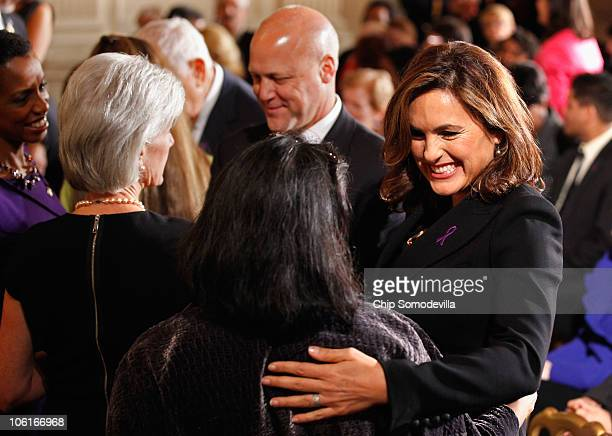 Actress Mariska Hargitay embraces White House Council on Women and Girls Executive Director Tina Tchen during a Domestic Violence Awareness Month...