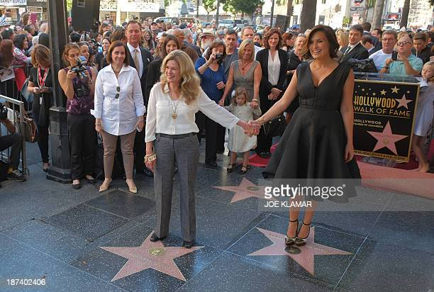 Actress Mariska Hargitay stands on her star while her sister Tina Hargitay stands on the star of their mother Jayne Mansfield on November 8 2013...