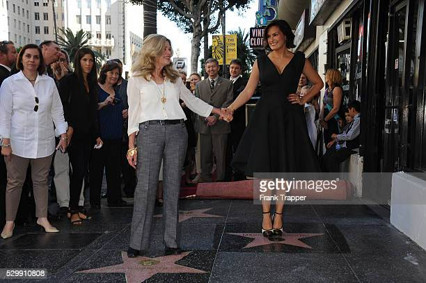 Actress Mariska Hargitay stands on her star while her sister Tina Hargitay stands on the star of their mother Jayne Mansfield at the ceremony that...