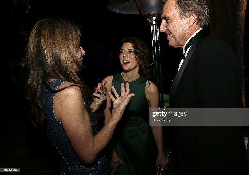Actress Marissa Tomei, center, attends the Bloomberg Vanity Fair White House Correspondents' Association (WHCA) dinner afterparty in Washington, D.C., U.S., on Saturday, April 27, 2013. The 99th annual dinner raises money for WHCA scholarships and honors the recipients of the organization's journalism awards. Photographer: Scott Eells/Bloomberg via Getty Images