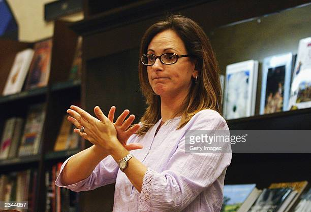 Actress Marlee Matlin answers a question about her new book 'Deaf Child Crossing' at Barnes Nobles bookstore on July 29 2003 in Encino California