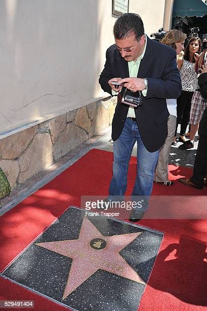Actress Marlee Matlin's husband Kevin Grandalski photographs her star on the Hollywood Walk of Fame