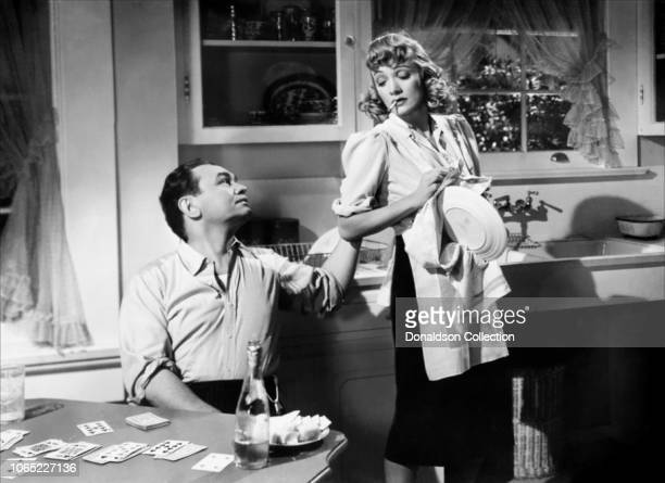 Actress Marlene Dietrich and Edward G Robinson in a scene from the movie Manpower