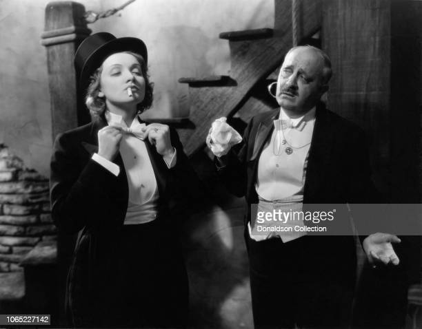 """Actress Marlene Dietrich and Paul Porcasi in a scene from the movie """"Morocco"""""""