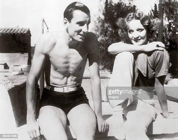 Actress Marlene Dietrich and tennis player Fred Perry in Palm Springs. Photography. . [Die Schauspielerin Marlene Dietrich und der Tennisspieler Fred...