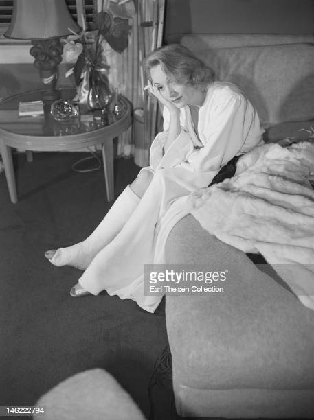 Actress Marlene Dietrich nurses a broken ankle after tripping on the set in September 1941 in Los Angeles California