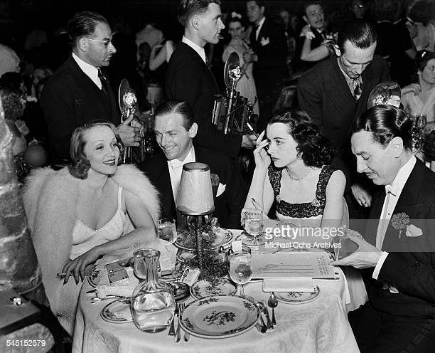 Actress Marlene Dietrich with actor Douglas Fairbanks Jr and actress Hedy Lamarr attend an event in Los Angeles California