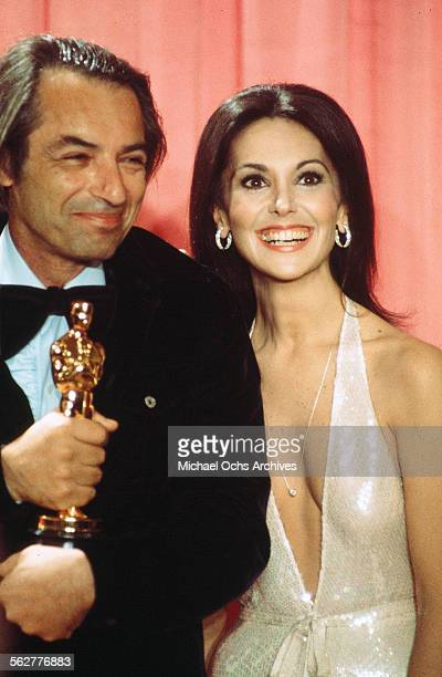 Actress Marlo Thomas poses backstage with Leonard Rosenman winner of Best Original Song Score or Adaptation Score during the 48th Academy Awards at...