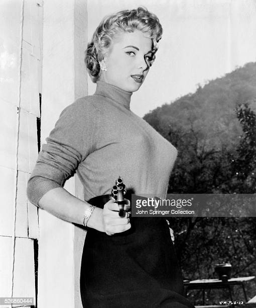 Actress Martha Hyer Pointing Revolver