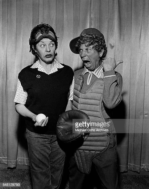 Actress Martha Raye poses with Harpo Marx for the The Martha Raye Show in New York New York