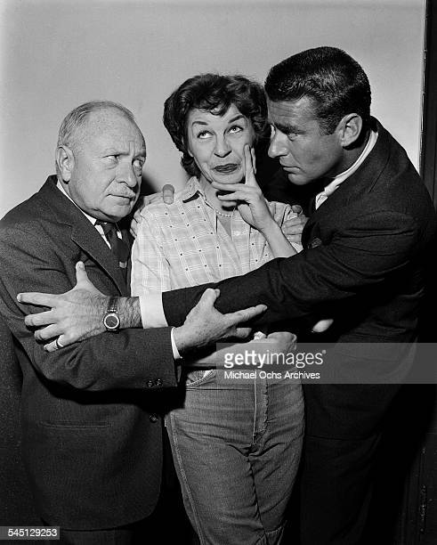 Actress Martha Raye poses with Peter Lawford and Jackie Coogan for the Martha Raye Show show hosted by Martha Raye in New York New York