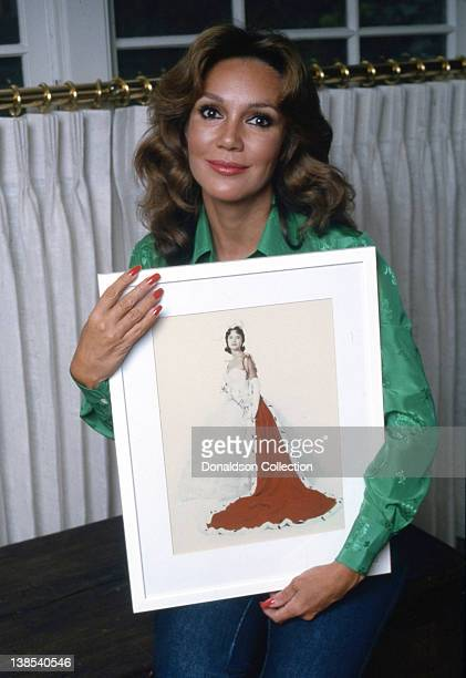 Actress Mary Ann Mobley poses for a portrait holding a picture of herself as a beauty queen in her home in circa 1980 in Los Angeles California
