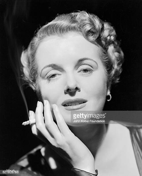 Actress Mary Astor in a promotional headshot holding a cigarette circa 19451955