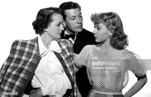 Actress Mary Astor Philip Dorn and Gloria Grahame in a scene from the movieBlonde Fever