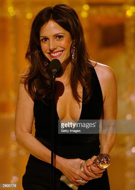 Actress Mary Louise Parker celebrates winning the Actress Supporting Role Series Mini-Series TV Movie award on stage at the 61st Annual Golden Globe...