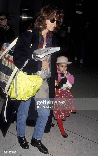 Actress Mary McDonnell and daughter Olivia McDonnell being photographed on March 4 1993 at Los Angeles International Airport in Los Angeles California
