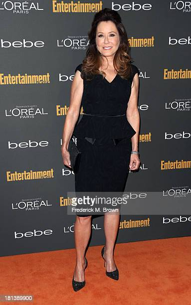 Actress Mary McDonnell arrives at Entertainment Weekly's PreEmmy Party at Fig Olive Melrose Place on September 20 2013 in West Hollywood California